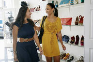 Women shopping together in shoe store - BLEF06815