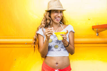 Smiling woman eating shaved ice - BLEF06989