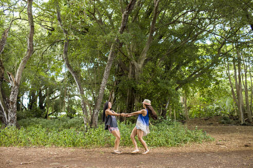 Pacific Islander women playing in forest - BLEF07007