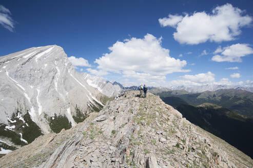 Mountain peak overlooking remote landscape - MINF12348