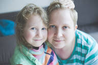 Portrait of smiling mother with daughter at home - IHF00115