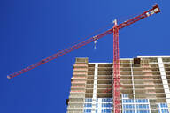 Low angle view of crane building highrise - MINF12478