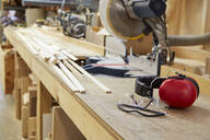 Wood, workbenches and tools in workshop - MINF12546