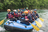 Group of people rafting in rubber dinghy on a river - FBAF00736