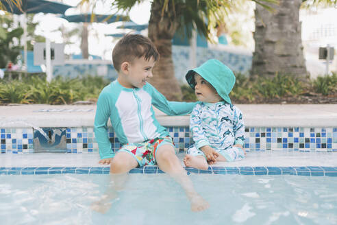 Happy little brothers at a swimming pool - CMSF00069