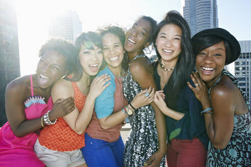 Women hugging on urban rooftop - BLEF07072