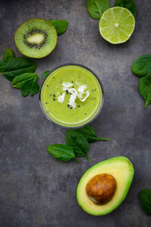 Green smoothie with avocado, spinach, kiwi and lime, coconut flakes and black sesame - LVF08105