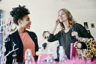 Women shopping together in store - BLEF07329