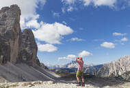 Hiker on hiking trail, Tre Cime di Lavaredo Aera, Nature Park Tre Cime, Unesco World Heritage Natural Site, Sexten Dolomites, Italy - GWF06114
