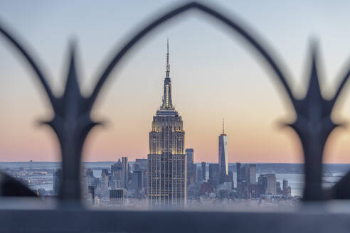 Skyline at sunset with Empire State Building in foreground and One World Trade Center in background, Manhattan, New York City, USA - MMAF01012
