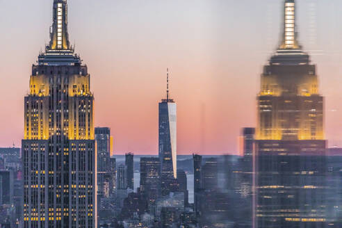 Skyline at sunset with Empire State Building in foreground and One World Trade Center in background, Manhattan, New York City, USA - MMAF01021