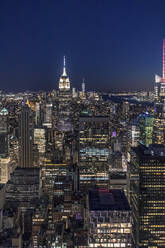Skyline at night with Empire State Building in foreground and One World Trade Center in background, Manhattan, New York City, USA - MMAF01033