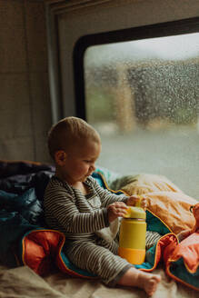Baby playing in motorhome, Queenstown, Canterbury, New Zealand - ISF21504