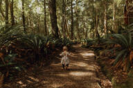 Baby girl exploring forest, Queenstown, Canterbury, New Zealand - ISF21507