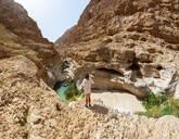 Man enjoying the view over Wadi Shab, Oman - WWF05133