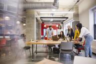 Business people working at laptops in meeting - HEROF36572
