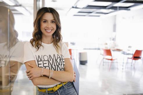 Portrait confident businesswoman in coworking space - HEROF36641