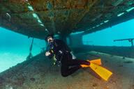 Diver exploring ship wreck, Ko Racha Yai, Rawai, Phuket, Thailand - ISF21691