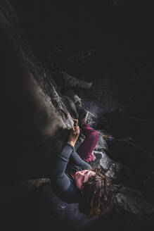 Climber bouldering in forest, Squamish, Canada - ISF21703