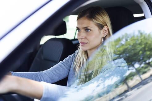 Young businesswoman driving her car - JSRF00311