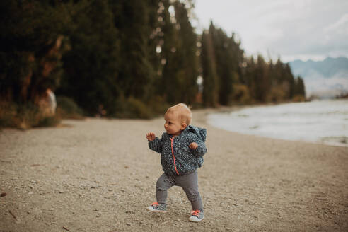 Baby walking on beach, Wanaka, Taranaki, New Zealand - ISF21825