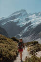 Hiker exploring wilderness, Wanaka, Taranaki, New Zealand - ISF21846