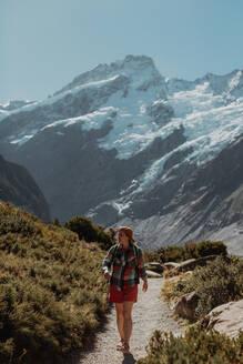 Hiker exploring wilderness, Wanaka, Taranaki, New Zealand - ISF21846