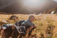 Baby exploring wilderness, Wanaka, Taranaki, New Zealand - ISF21849