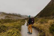 Hiker exploring trail, Wanaka, Taranaki, New Zealand - ISF21861