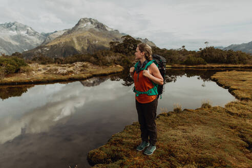 Hiker enjoying scenic lake view, Queenstown, Canterbury, New Zealand - ISF21912