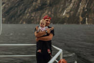 Father with baby on lake cruise, Queenstown, Canterbury, New Zealand - ISF21918