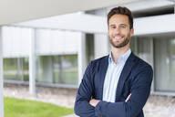 Portrait of smiling businessman outdoors - DIGF07076