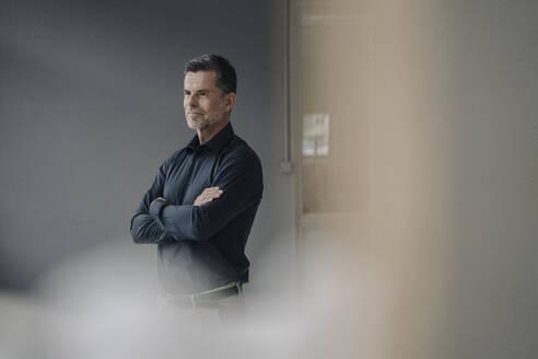 Portrait of confident mature businessman - KNSF06073
