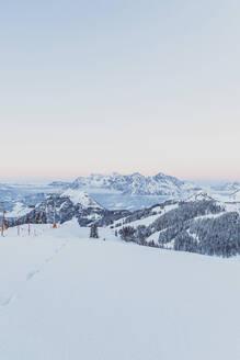 View over snowy mountains at dusk, Saalbach Hinterglemm, Pinzgau, Austria - MMAF01067