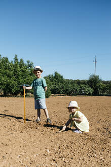 Boy and girl plowing the ground - JRFF03378