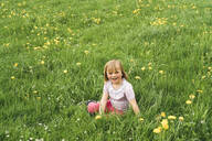 Portrait of happy girl in flower meadow - FBAF00765