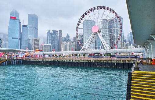 View to skyline with big wheel in the foreground, Victoria harbour, Central District, Hong Kong, China - MRF02098