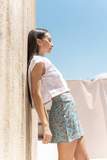 Fashionable young woman with eyes closed leaning at wall - AFVF03439