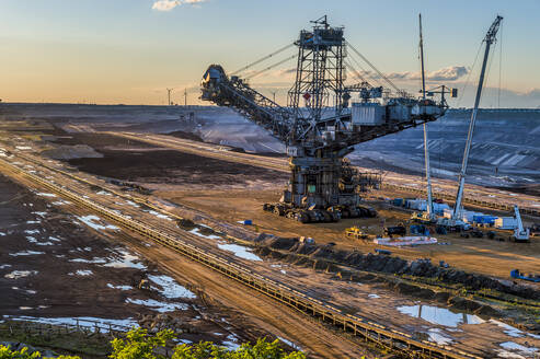 High angle view of bucket-wheel excavator at mine against sky during sunset - FR00855
