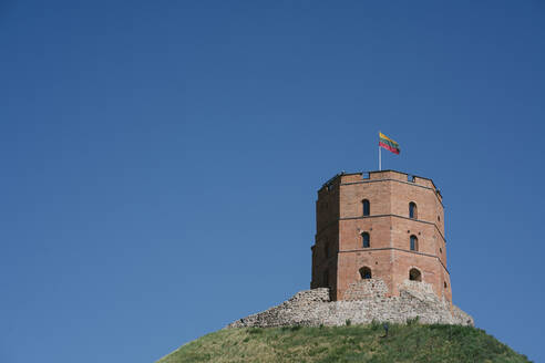 Low angle view of Gediminas Tower on hill against clear blue sky - AHSF00569