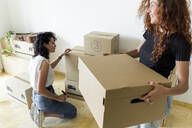 Two friends moving into new home - JPTF00214