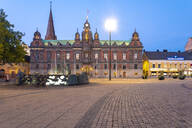 Illuminated town hall against blue sky at dusk in Malmo, Sweden - TAMF01663