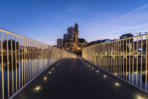 Illuminated footbridge against sky at night in Malmo, Sweden - TAMF01669