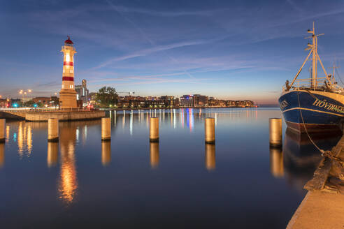 Malmo Old Light House by the harbor with an old ship anchored - TAMF01675