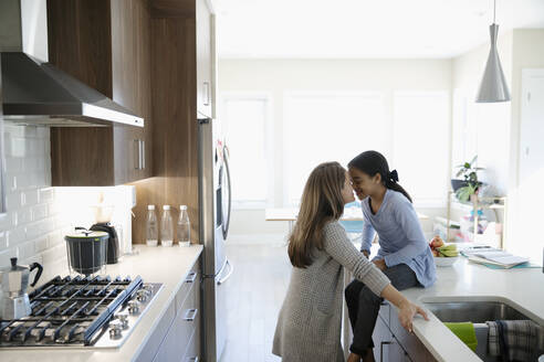 Affectionate mother and daughter in kitchen - HEROF36817