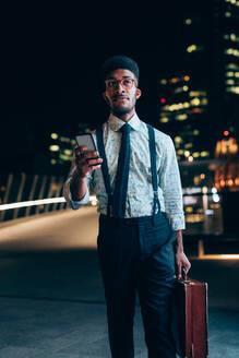 Businessman using smartphone on bridge - CUF52246