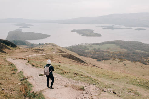 Trekker enjoying view of Loch Lomond, Trossachs National Park, Canada - CUF52525