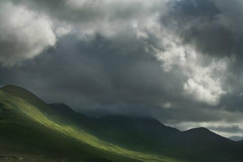 Sun break in clouds in rural landscape - BLEF07935