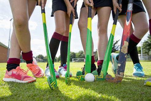 Legs of middle schoolgirls playing field hockey in physical education class - JUIF01725