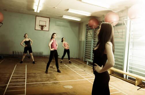 Caucasian dancers rehearsing in gym - BLEF08093